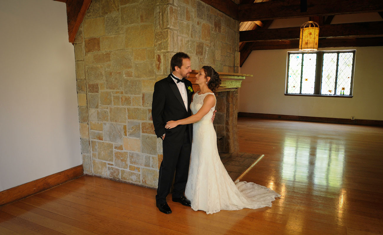 Couple by the Antiques Room Fireplace